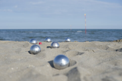 Italy, Adriatic Sea, boccia bowls in the sand - CRF002630