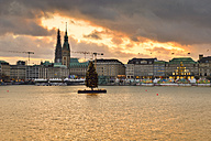 Germany, Hamburg, Inner Alster Lake, View of the Jungfernstieg with City Hall and St. Nicholas' Church at sunset - RJF000393