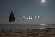 Italy, Sardinia, Tortoli, Cea beach, light painting boy in the moonlight - JBF000225