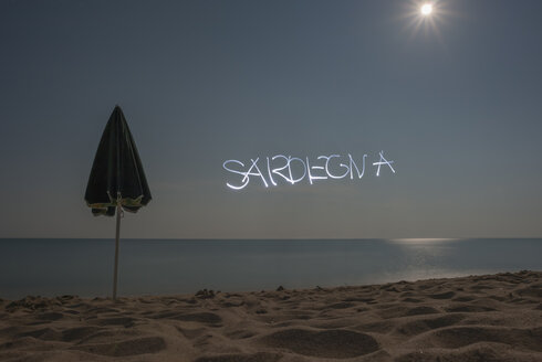 Italy, Sardinia, Tortoli, Cea beach, light painting boy in the moonlight - JBF000225