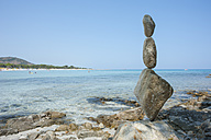 Italy, Sardinia, Golfo di Orosei, Cala Ginepro, trail marking coastal cairn at the beach - JBF000227
