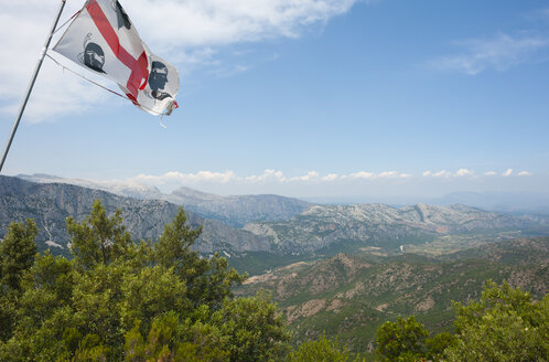 Italy, Sardinia, Supramonte mountains with Sardinian flag - JBF000232