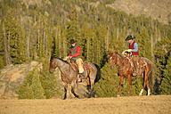 USA, Wyoming, two riding cowboys - RUEF001393