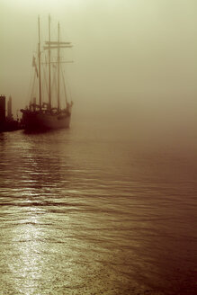 Germany, Hamburg, sailing ship in fog - KRPF001218