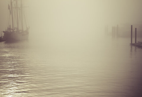 Germany, Hamburg, sailing ship in fog - KRPF001174