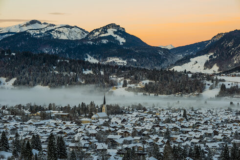 Germany, Bavaria, view to Allgaeu Alps with snow-covered Oberstdorf in the foreground - WGF000563