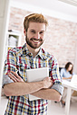 Portrait of confident young man in office - WESTF020673