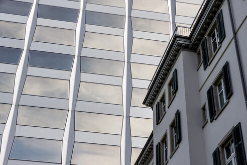 Switzerland, Zurich, facade of an old building and an office tower - EJWF000615