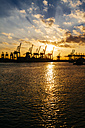 Germany, Hamburg, container cranes at sunset - KRPF001279