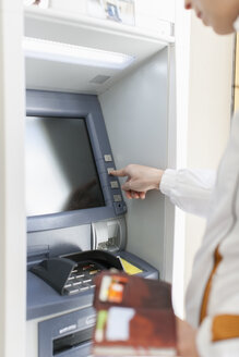 Woman at cash machine - NNF000191
