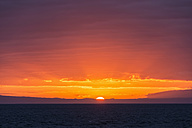 Pacific Ocean, Galapagos Islands, sunset above Santiago Island - FOF007591
