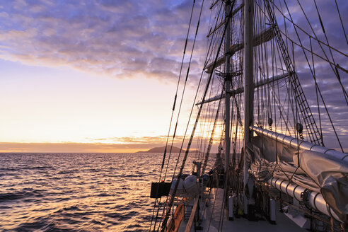 Pacific Ocean, sailing ship at Galapagos Islands at sunset - FOF007548