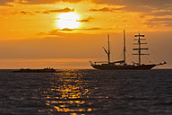 Pacific Ocean, sailing ship at Galapagos Islands at sunset - FOF007552