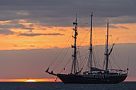 Pacific Ocean, sailing ship at Galapagos Islands at sunset - FO007554