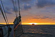 Pacific Ocean, sailing ship at Galapagos Islands at sunrise - FOF007568