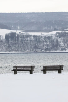 Germany, Lake Constance and benches in winter - JTF000612