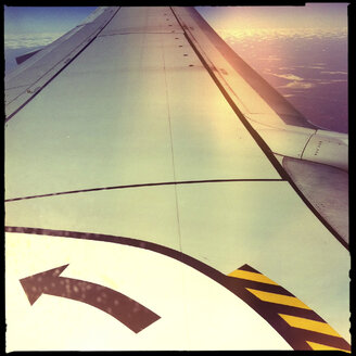 jet, airplane, wing, sign, arrow, left, clouds, stripes, aerial view, northern territory, australia - LUL000077