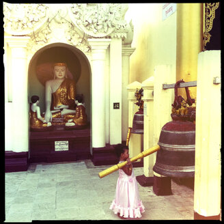little girl knocking the holy bell, shwedagon pagoda, yangon, myanmar - LUL000110