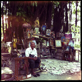 man selling holy buddhist, pictures and figures, mandalay, myanmar - LUL000150