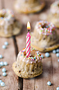 Miniature birthday cake with lighted candle - ODF001031