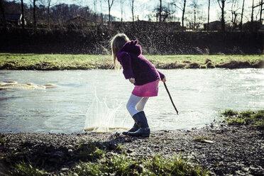 Little girl splashing with water - SARF001239
