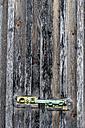 Locked bar of wooden door - EJWF000639