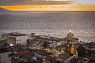 Mexico, Puerto Vallarta, lighted Church of Our Lady of Guadalupe at sunset - ABAF001612