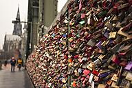 Germany, North Rine-Westphalia, Cologne, Love locks at Hohenzollern Bridge - ZM000358