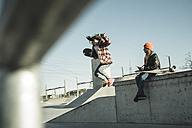 Two girls in skatepark - UUF003078