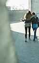 Two teenage girls embracing in skatepark - UUF003062