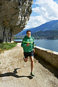 Italy, Trentino, man running at Lake Garda - MRF001472