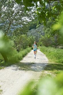 Italy, Trentino, woman running near Lake Garda - MRF001485