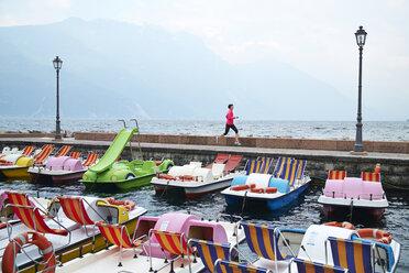 Italy, Trentino, woman running near at Garda - MRF001502