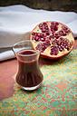 Glass of pomegranate juice and half of pomegranate - LVF002624