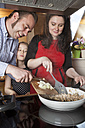 Parents and daughter cooking together - PAT000017