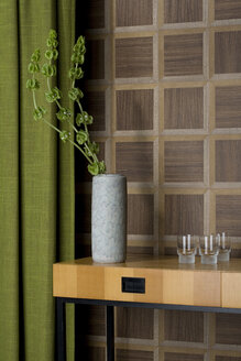 Sideboard with glasses and flower vase in front of wooden wall cladding - PATF000026
