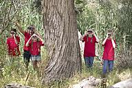 South Africa, Kids on field trip exploring nature, looking through binoculars - ZEF003952
