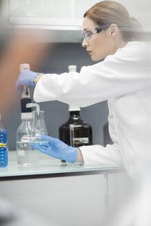 Scientist in lab working with liquid - ZEF004237