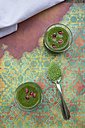 Two glasses of wheatgrass smoothie with pomegranate seeds - LVF002635