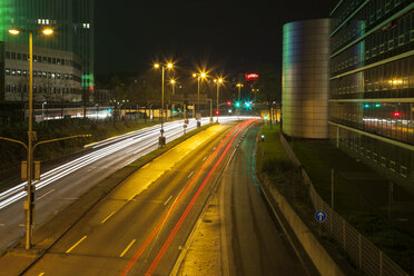 Germany, Duesseldorf, media harbor, light trails on road at night - WIF001366