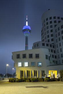 Germany, Duesseldorf, media harbor, Neuer Zollhof and Rhine Tower at night - WI001376