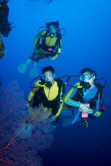 Pacific Ocean, Palau, scuba divers at steep face - JWAF000208