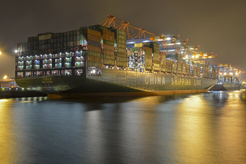 Germany, Hamburg, Container ship Globe at night - RJ000396