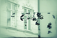 Shoes hanging on clothesline - CST000775