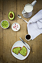 Bread with avocado cream, yogurt with pomegranate seeds and cup of coffee - LVF002657