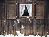 Germany, Black Forest, window of wooden hut in winter - KRPF001265