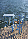 Greece, Limenas Geraka, chair and table at the Sea - WWF003477