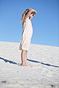 Girl standing on beach looking into the distance - ZEF004771