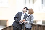 Business people taking a break, drinking coffee - ZEF003868