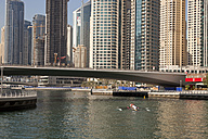 UAE, Dubai, rowing boat in front of skyscrapers at Dubai Marina - PCF000019